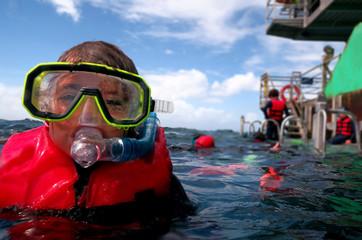 Little girl prepare to  snorkeling dive