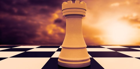 Composite image of white rook on chess board