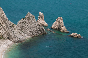 The famous beach of Conero: lspiaggia delle due sorelle in the marche region, Italy.