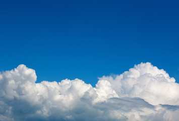 Beautiful nature background of blue sky and white clouds