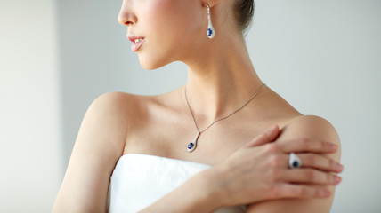 beautiful woman with earring, ring and pendant