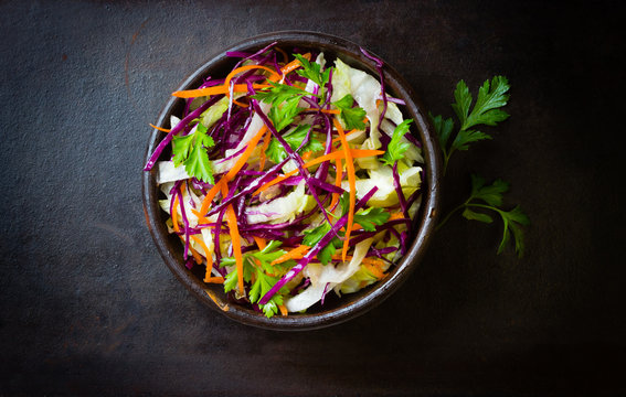 Fresh vegetables salad purple cabbage, lettuce, carrot. Top view