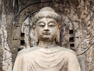 Stone buddhist statue in Longmen Grottoes, China