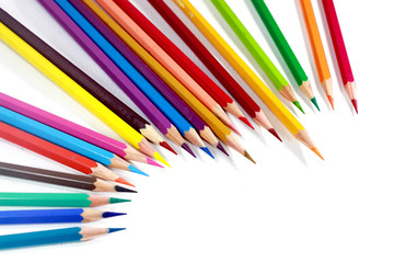 Multicolor colored pencils or crayons in white background.