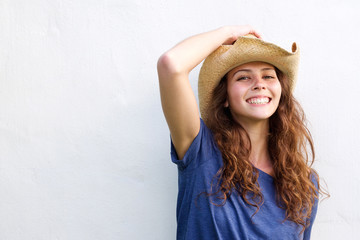 Smiling young woman with cowboy hat