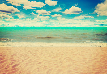 sand beach sea and blue sky clouds with vintage tone.