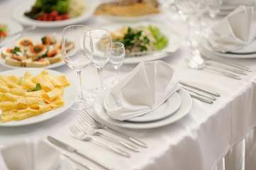 table set service with silverware and glass stemware at restaura