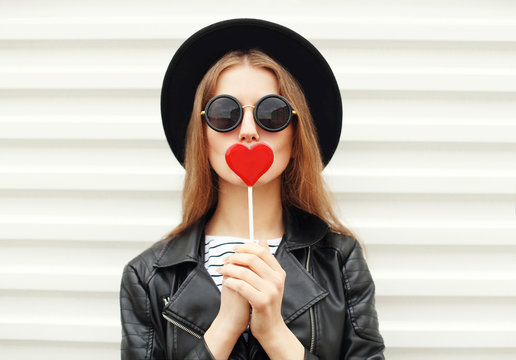 Fashion sweet woman having fun with lollipop over white backgrou