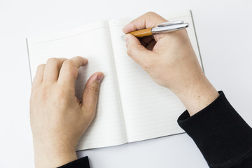 a person beginning to write on a blank book