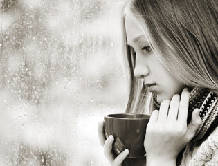 Girl Drinking Tea in the Rainy Day
