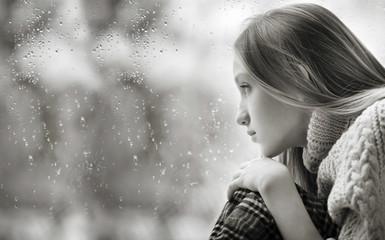 Rainy Day: sad Girl on the Window Black And White