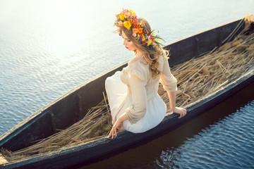 Beautiful girl sitting in the boat