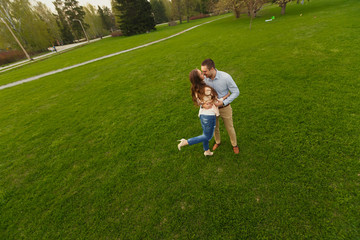 Happy Smiling Couple Relaxing on Green Grass.Park