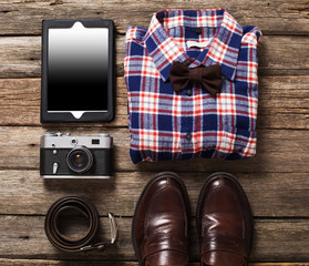 Tourism concept - set of stuff with camera and other travel things on wooden table background