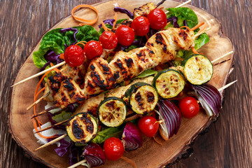Chicken kebab with vegetables grilled on BBQ.