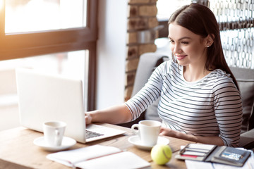 Positive woman sitting at the table