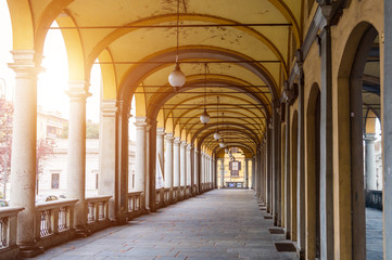 Italy, Novara. Yellow arches with white columns.  Toning.