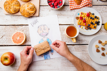 Childs drawing of her dad. Fathers day. Breakfast meal.