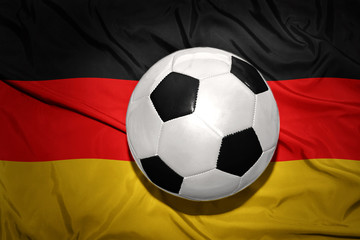 black and white football ball on the national flag of germany