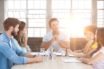Composite image of business people during a meeting