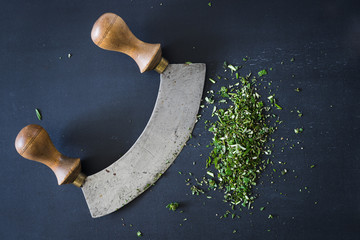 Italian traditional old mezzaluna knife used to chop aromatic herbs