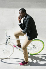 African man with mobile phone and bicycle.