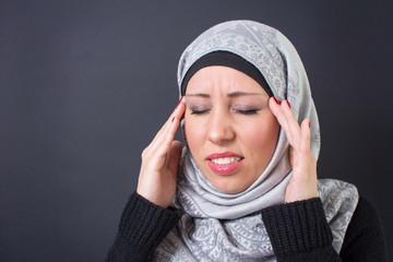 Muslim woman with a headache