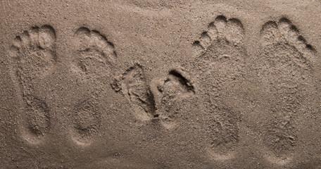 family footprints on sand