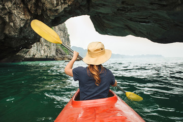 Woman explore Ha Long Bay on kayak