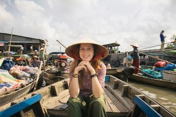 Woman tourist explore vietnamese culture in Mekong Delta river
