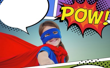 Composite image of smiling masked girl pretending to be superher
