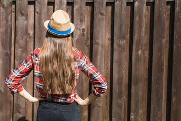 Girl in straw hat and shirt in country