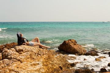 Beautiful girl relaxing on ocean beach