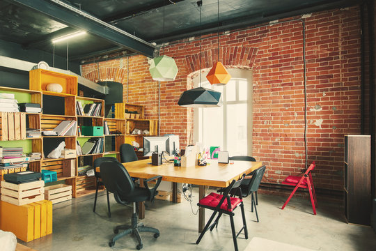 Modern office Interior with old vintage brick Wall. Art work  space