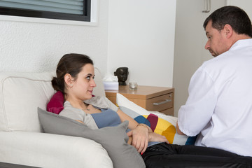 Experienced male therapist listening to his patient