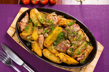 meat with potatoes in pen