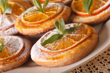 Almond cookies with oranges mint macro on a plate. horizontal