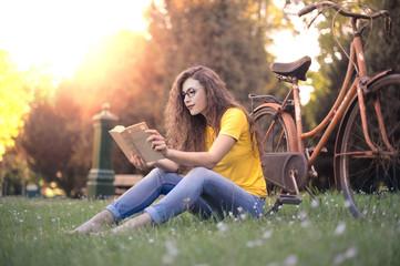 Girl reading a book outdoors