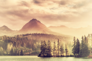 Vintage Sunset over a Lake in Mountains