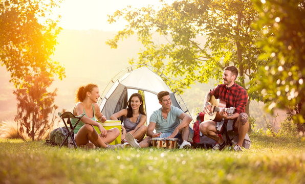 young friends have good time on camping trip