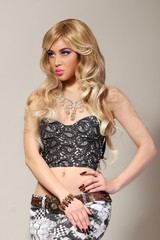 Beautiful blonde in a Hollywood manner with curls, red lips. Bea