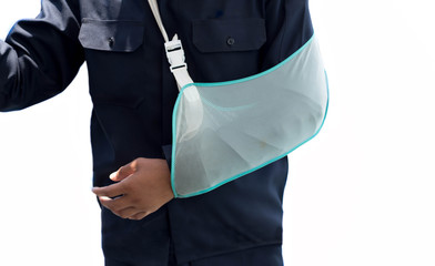 Man with hand injured wearing an arm brace isolated