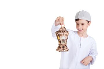 Ramadan Kareem - Happy young kid playing with Ramadan lantern