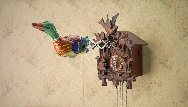 Tin toy duck coming out of Cuckoo Clock