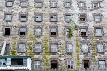 Abandoned building with many windows in decay, central parts of Dublin, Ireland.