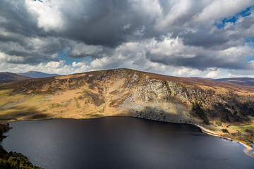 Wonderful view of mountains, lake and dramatic sky with clouds. Wicklow Ireland.