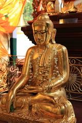 Buddha statue at Shwedagon Paya in Yangon, Myanmar