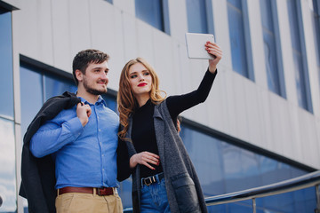 Brutal guy and a cute girl doing a selfie.