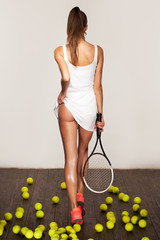 beautiful fitness sexy woman, tennis player with racket