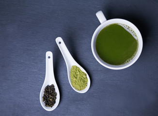 Wall Mural - Matcha tea in a cup on the black background